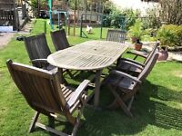 Hardwood garden table and six folding chairs