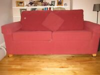 Two seater bed settee and matching armchair - very good condition