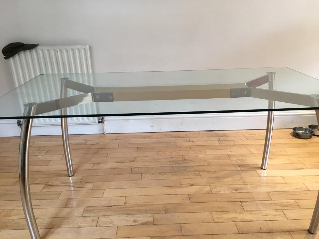 Dining table with glass top and metal legs