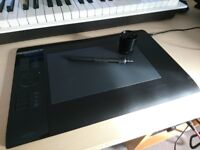 Wacom Intuos 4 graphics tablet (size M) inc pen and extra nibs. Perfect for designers and artists.