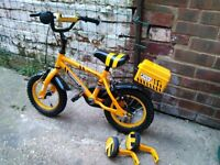 First bike with training wheels and tool box