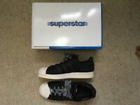 Black and white wax size 4 Adidas superstar trainers