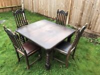Antique Edwardian solid oak dining table barley twist legs and vintage chairs.