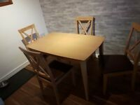 Beech dining table with 4 brown leather chairs