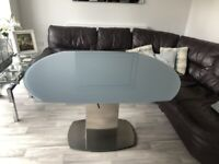 flow swivel glass dining table
