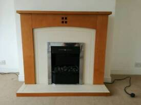 Electric fire and wood fireplace surround