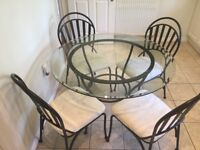 Table and Chairs, John Lewis quality, round glass top, gunmetal grey chairs, cream fabric.