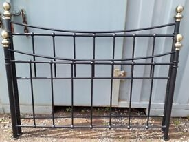 Black double bed frame with brass details