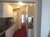 Extended 3 bedroom house with off street parking for two cars, a rear garden and storage shed.