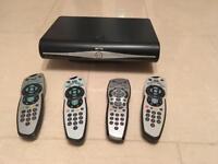 SkyHD Box and 4 remotes