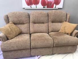 Three piece suite in oatmeal colour with matching armchairs