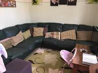 Large green corner sofa