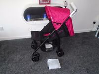 Brand new in box lie flat umberella buggy with raincover