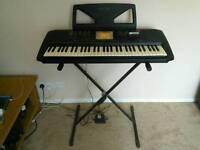 Yamaha PSR-530 keyboard and stand
