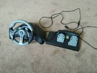 Xbox 360 steering wheel and pedals