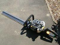 Titan petrol hedge trimmer,as new,75cm cutting blade