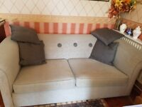 Virtually new - 3 seater Grey sofa with dark button detail and matching throw cushions. 2.3m wide