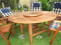 SOLID TEAK GARDEN FURNITURE SET by Hartman. (wooden)