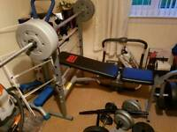 Weights bench with leg curl