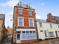 An impressive recently converted first floor one bedroom apartment in the heart of town