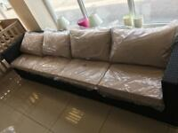 Brand New 4 Seater Rattan Effect Sofa there are 2 sofas which can be split if required .