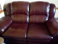2 Leather Reclining Sofas.