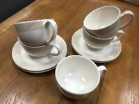 Set of four cappuccino cups & saucers, one spare cup.