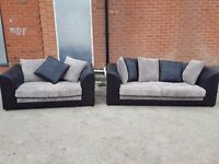 Cute black and grey cord sofa suite. 3 and 2 seater sofas. 1 month old. clean. can deliver