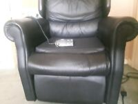Black, Faux Leather Riser Recliner Chair. Motor needing fixed!
