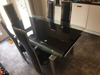 Black Glass Extending Dining Table and Chairs - QUICK SALE £100. COLLECTION ONLY. Based in WITHAM