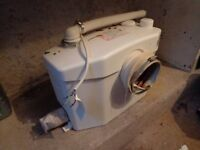Toilet macerator/saniflow type unit. Used but still worked on removal from bathroom.