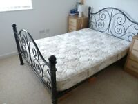 metal frame bed, mattress & two side tables.