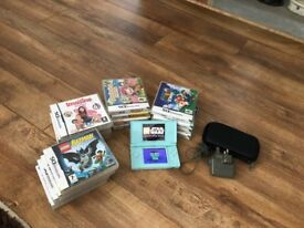 Pale Blue Nintendo DS Lite and assortment of games