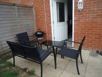 Garden patio set (comprises, 2 seater chair, glass table and 2 x chairs )must go asap moving w/end