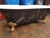 Cast iron claw feet rolltop bath