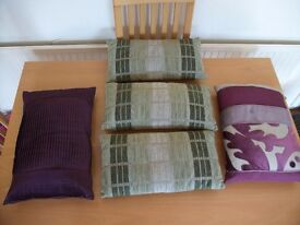 Three rectangular cushions in three shades of green colour