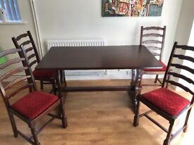 Mahogany dining table and 4 chairs.