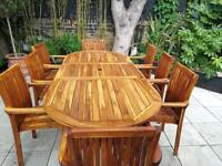Solid teak extending garden table, 8 chairs and carved bench