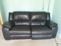 Dark brown leather reclining sofa and two reclining armchairs