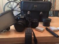 Canon EOS Rebel T2i (550d) + Batteries, case, fisheye lens, 50mm prime lens, videolight & more