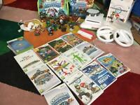 Fab Nintendo Wii collection with console, wii fit, sky landers figures, bag and tons more!!