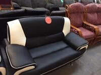 Black and white leather 3&2 seater sofas
