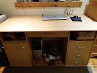 Large desk with built-in drawers