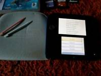 Nintendo 2DS with mario kart 7 preloaded and games