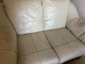 Cream leather 2 seater sofa with foot stool