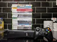 Xbox 360 Slim in perfect working condition and 16 games.