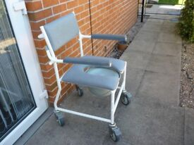 Shower and toilet commode chair. Unused.