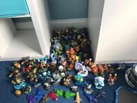 50+ SKYLANDERS FIGURES & 4 Wii SKYLANDER GAMES