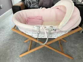 Pink and white Moses basket with mamas and papas stand