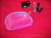 Pink Estee Lauder with skin care products